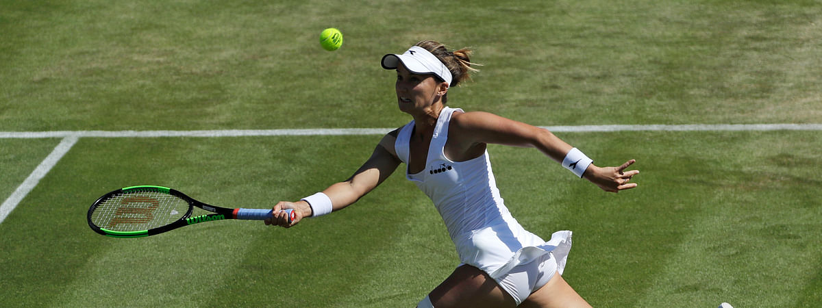 United States' Lauren Davis returns to Germany's Angelique Kerber in a Women's singles match during day four of the Wimbledon Tennis Championships in London, Thursday, July 4, 2019. (AP Photo/Ben Curtis)