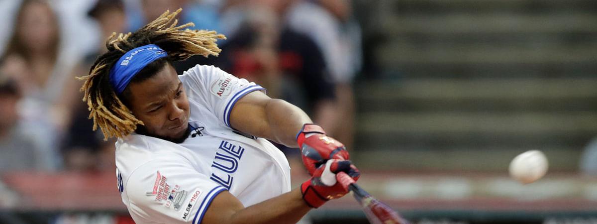 Blue Jays' Vladimir Guerrero Jr. belts one of the many home runs hit Monday night (Tony Dejak)