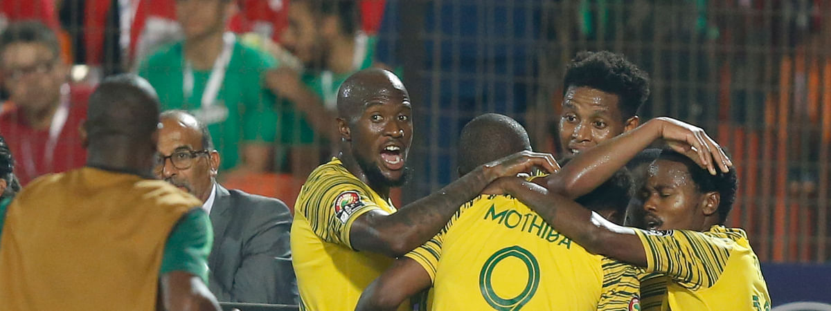 South African players celebrate after a goal during the African Cup of Nations round of 16 soccer match between Egypt and South Africa in Cairo International stadium in Cairo, Egypt, Saturday, July 6, 2019. (AP Photo/Ariel Schalit)