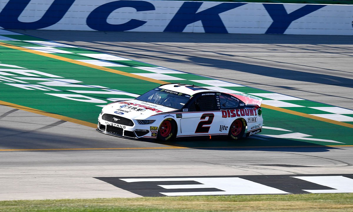 Brad Keselowski crosses the finish line during qualifying for a NASCAR Series auto race at Kentucky Speedway in Sparta, Ky., Friday, July 12, 2019. (AP Photo/Timothy D. Easley)