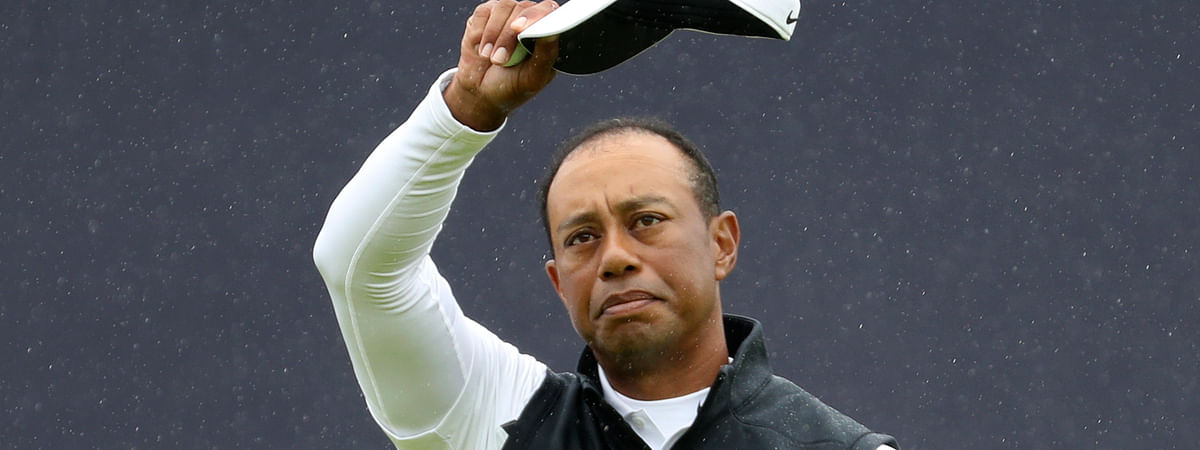 Tiger Woods waves goodbye to the 2019 British Open after his second round at Royal Portrush in Northern Ireland, Friday, July 19, 2019. Woods finished at 6 over par for the two rounds. (AP Photo/Peter Morrison)