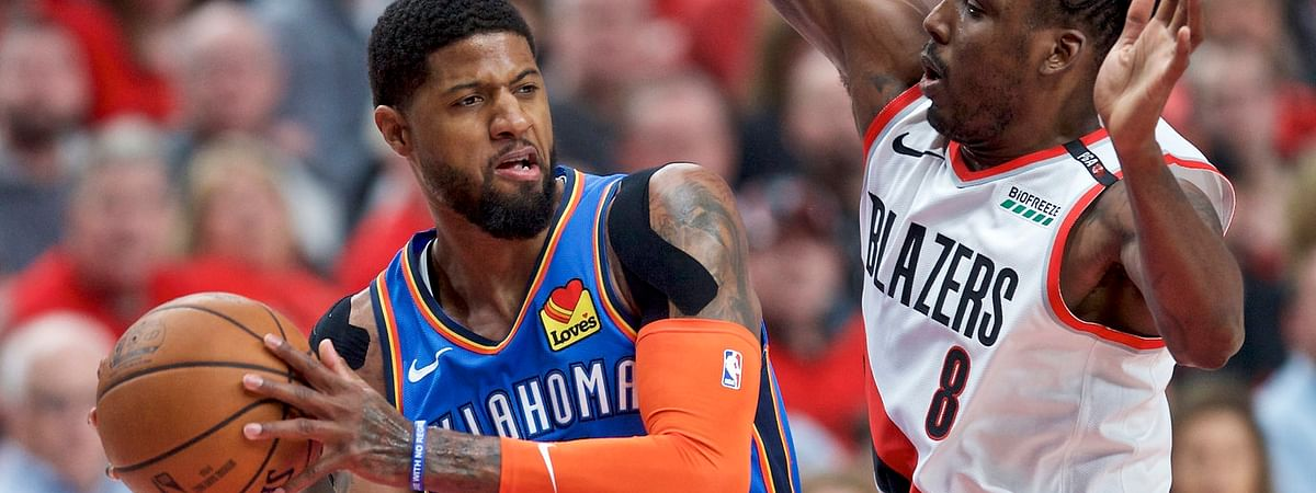 Portland's Al-Farouq Aminu guards Thunder's Paul George in a playoff game on April 16 (Craig Mitchelldyer)