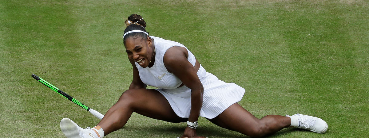 United States' Serena Williams does the splits after playing a return to United States' Alison Riske in a Women's quarterfinal singles match on day eight of the Wimbledon Tennis Championships in London, Tuesday, July 9, 2019.
