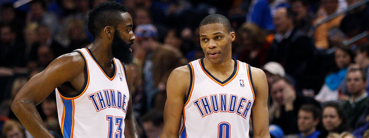 In this Jan. 25, 2012 photo Oklahoma City Thunder guard James Harden, left, talks with teammate Russell Westbrook in the fourth quarter of an NBA basketball game in Oklahoma City.
