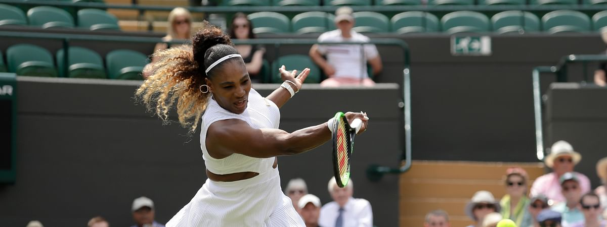 United States' Serena Williams returns the ball to Spain's Carla Suarez Navarro in a women's singles match during day seven of the Wimbledon Tennis Championships in London, Monday, July 8, 2019.