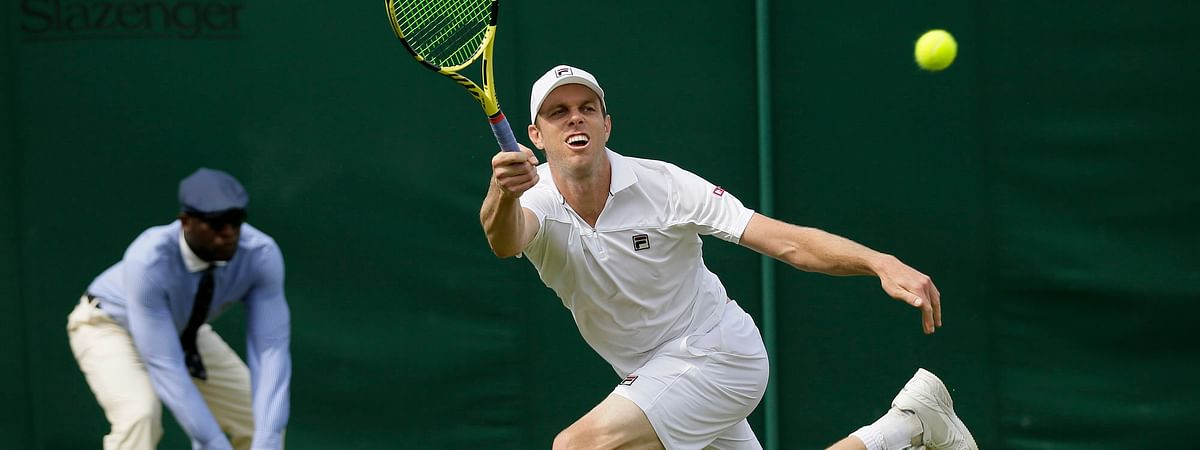 Sam Querrey serves to  Tennys Sandgren in a men's singles match on July 8. Both me were once crowned national champions at Kalamazoo. (AP Photo/Tim Ireland)