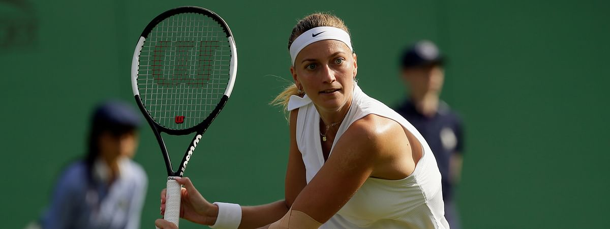 Czech Republic's Petra Kvitova returns to Tunisia's Ons Jabeur in a Women's singles match during day two of the Wimbledon Tennis Championships in London, Tuesday, July 2, 2019. (AP Photo/Tim Ireland)