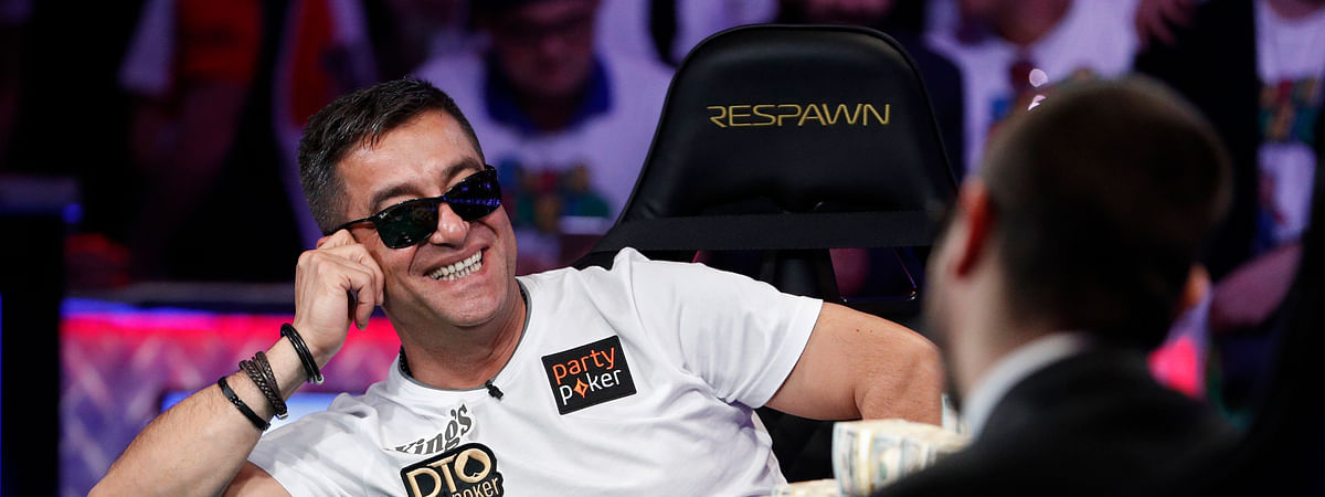 Hossein Ensan, of Germany, reacts after a hand at the final table of the World Series of Poker main event Tuesday, July 16, 2019, in Las Vegas. (AP Photo/John Locher)