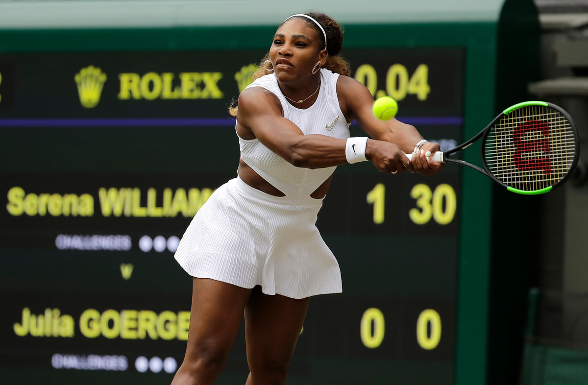 United States' Serena Williams returns to Germany's Julia Goerges in a Women's singles match during day six of the Wimbledon Tennis Championships in London, Saturday, July 6, 2019. (AP Photo/Ben Curtis)