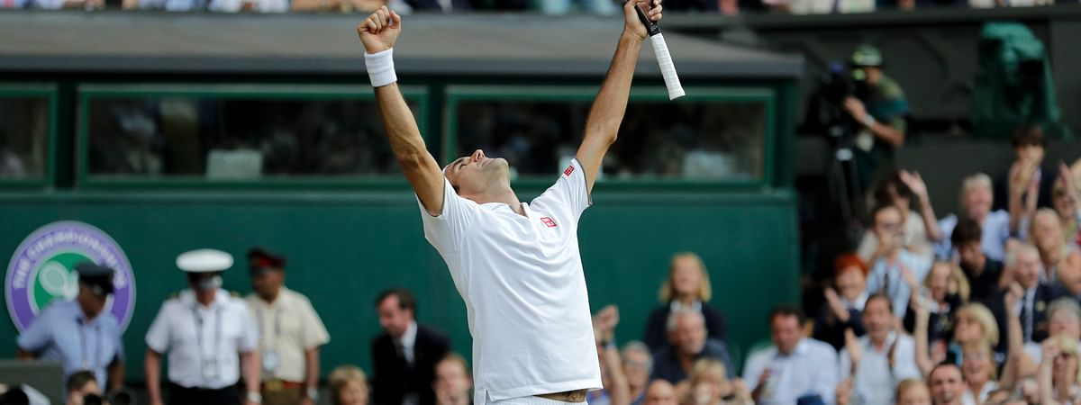 Switzerland's Roger Federer celebrates defeating Spain's Rafael Nadal during a men's singles semifinal match on day eleven of the Wimbledon Tennis Championships in London, Friday, July 12, 2019. (AP Photo/Ben Curtis)