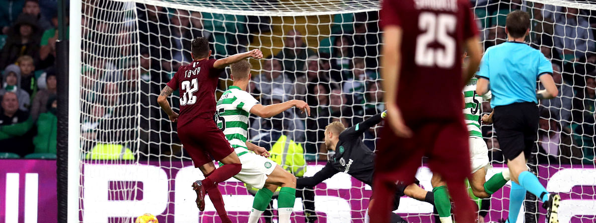 FK Sarajevo's Benjamin Tatar, left, scores against Celtic during the Champions League first qualifying round, second leg soccer match at Celtic Park, Glasgow, Scotland, on July 17, 2019.