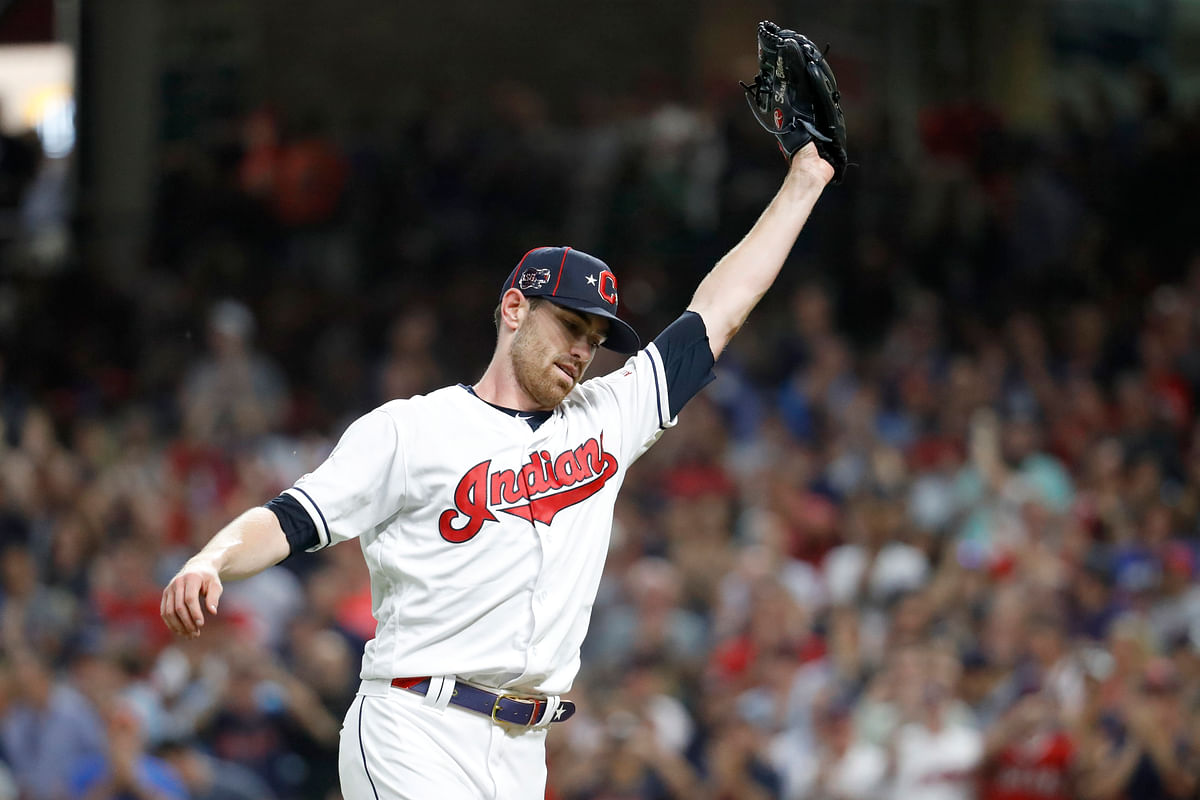 American League pitcher Shane Bieber, of the Cleveland Indians, reacts after striking out National League's Ronald Acuna Jr., of the Atlanta Braves, to end the top of the fifth inning of the MLB  All-Star Game, Tuesday, July 9, 2019, in Cleveland. (AP Photo/John Minchillo)
