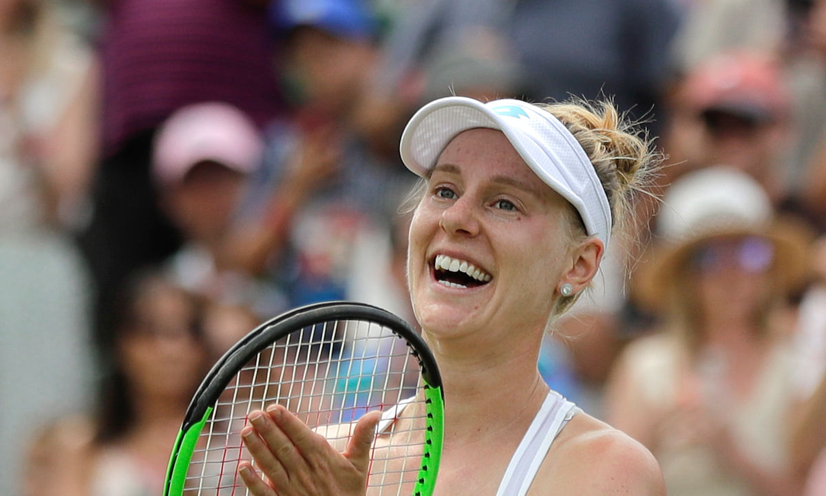 Alison Riske celebrates defeating Ashleigh Barty at Wimbledon last July. Riske will play in the finals of the UTR Pro Match Series Sunday in West Palm Beach. (AP Photo/Ben Curtis)