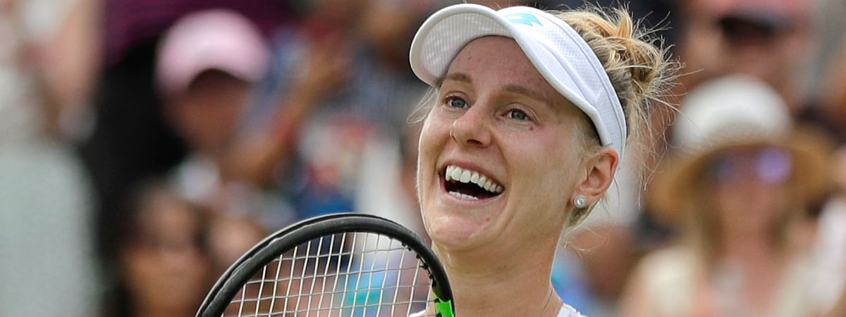 United States' Alison Riske celebrates defeating Australia's Ashleigh Barty in a women's singles match during day seven of the Wimbledon Tennis Championships in London, Monday, July 8, 2019. (AP Photo/Ben Curtis)