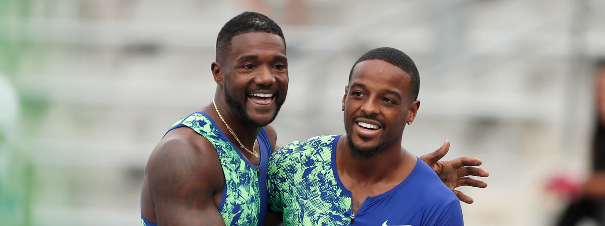 Isiah Young celebrates with Justin Gatlin, left, after winning his preliminary heat in the men's 100-meter dash at the U.S. Championships athletics meet, Thursday, July 25, 2019, in Des Moines, Iowa. (AP Photo/Charlie Neibergall)