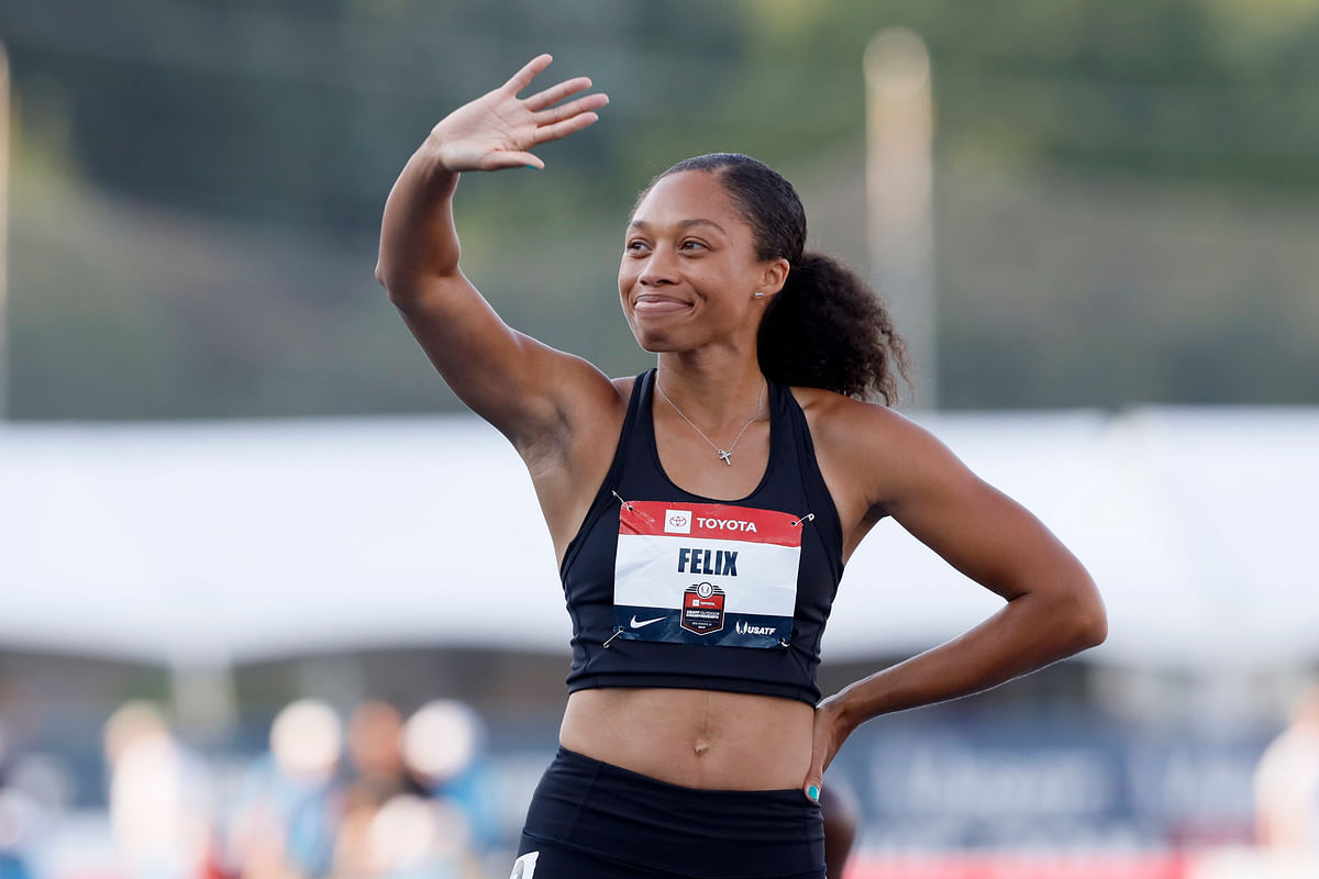 Allyson Felix waves to fans before her 400-meter dash heat at the U.S. Championships athletics meet, Friday, July 26, 2019, in Des Moines, Iowa. (AP Photo/Charlie Neibergall)