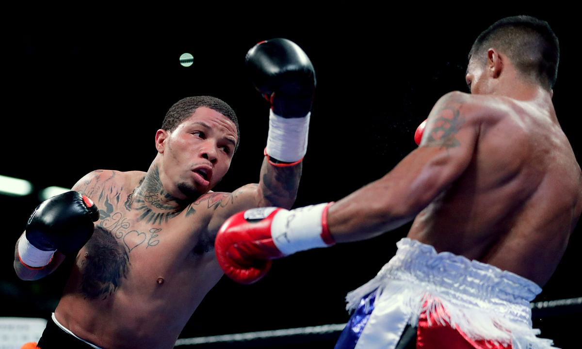 Gervonta Davis, left, throws a punch at Ricardo Nunez during the second round of their super featherweight boxing championship bout, Saturday, July 27, 2019, in Baltimore. (AP Photo/Julio Cortez)