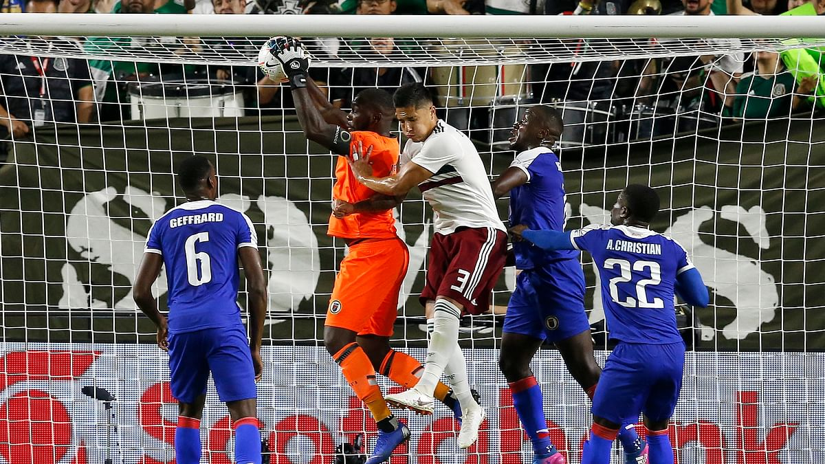 Mexico scores on a penalty kick 93 minutes in to beat Haiti 1-0 in the CONCACAF Gold Cup semifinals