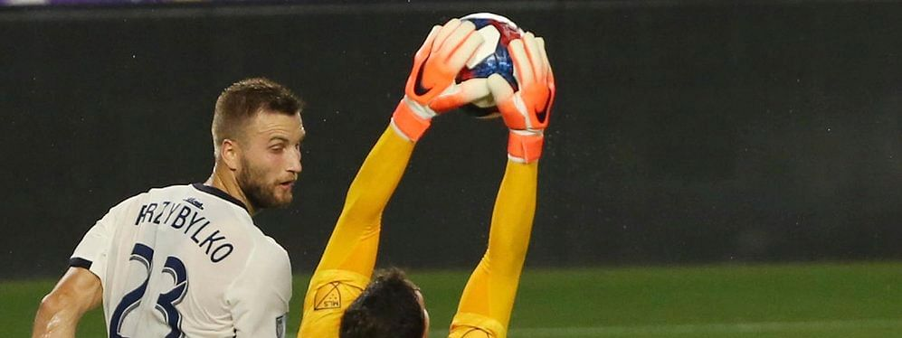 Union's Kacper Przybylko (23) watches goalie Matt Freese make a save against Orlando City July (Stephen M. Dowell/Orlando Sentinel)