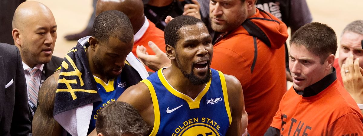 In this June 10, 2019, file photo, Golden State Warriors forward Kevin Durant reacts as he leaves the court after sustaining an injury during first-half basketball action against the Toronto Raptors in Game 5 of the NBA Finals in Toronto.