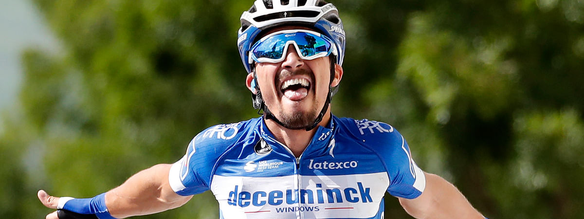 France's Julian Alaphilippe celebrates as he crosses the finish line to win the third stage of the Tour de France cycling race over 215 kilometers (133,6 miles) with start in Binche and finish in Epernay, Monday, July 8, 2019. (AP Photo/Christophe Ena)