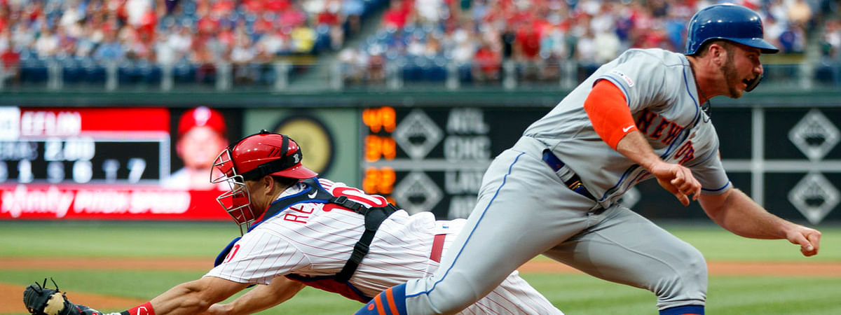 Mets' Pete Alonso eases past  Phillies catcher J.T. Realmuto to score a first-inning run against Zach Eflin on June 24 (Matt Slocum)