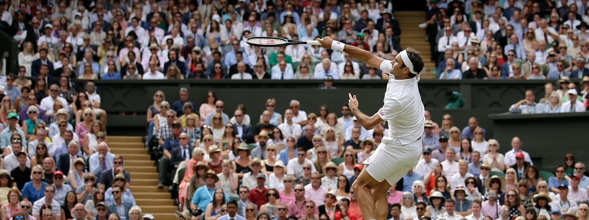 Switzerland's Roger Federer returns the ball to Serbia's Novak Djokovic during the men's singles final match of the Wimbledon Tennis Championships in London, Sunday, July 14, 2019.