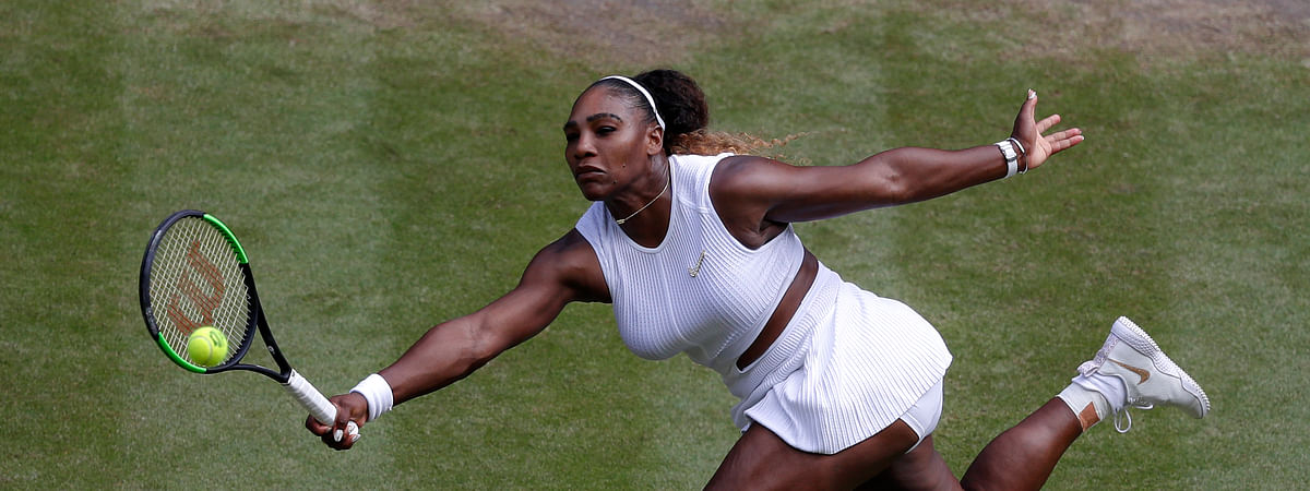 United States' Serena Williams returns to Czech Republic's Barbora Strycova during a women's singles semifinal match on day ten of the Wimbledon Tennis Championships in London, Thursday, July 11, 2019. (AP Photo/Alastair Grant)