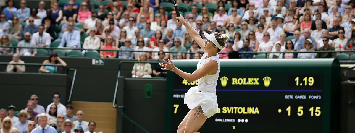 Ukraine's Elina Svitolina returns the ball to Czech Republic's Karolina Muchova during a women's quarterfinal match on day eight of the Wimbledon Tennis Championships in London, Tuesday, July 9, 2019.