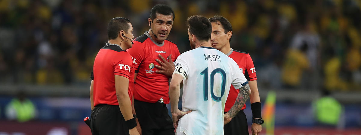 Argentina's Lionel Messi complains with referee Roddy Zambrano, center, during a Copa America semifinal soccer match at the Mineirao stadium in Belo Horizonte, Brazil, Tuesday, July 2, 2019. (AP Photo/Ricardo Mazalan)