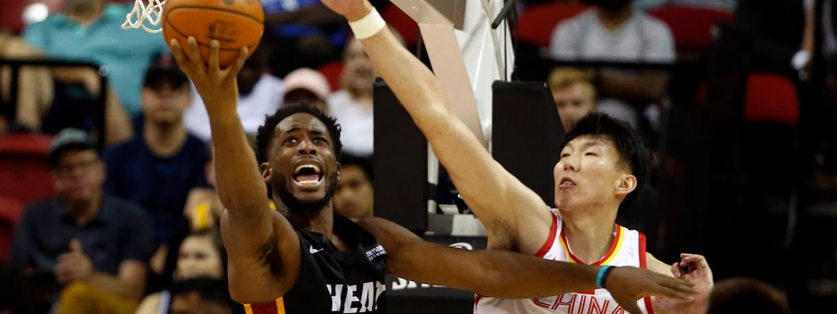 Miami Heat's Yante Maten (0) lays up the ball against China's Zhou Qi (15) during an NBA summer league basketball game Friday, July 5, 2019, in Las Vegas. (AP Photo/Steve Marcus)