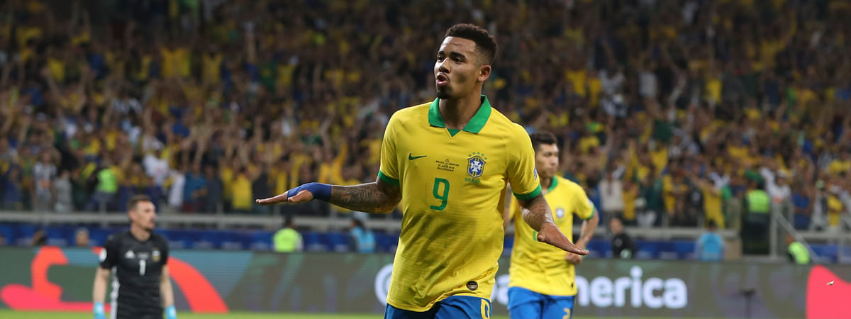 Brazil's Gabriel Jesus celebrates his side's 2nd goal scored by teammate Roberto Firmino, back, during a Copa America semifinal soccer match against Argentina at the Mineirao stadium in Belo Horizonte, Brazil, Tuesday, July 2, 2019. (AP Photo/Ricardo Mazalan)
