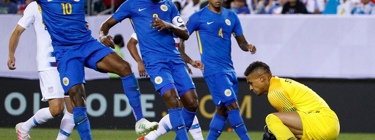 United States' Zack Steffen (in yellow) blocks a shot as Curacao's players watch on June 30 (Matt Slocum)
