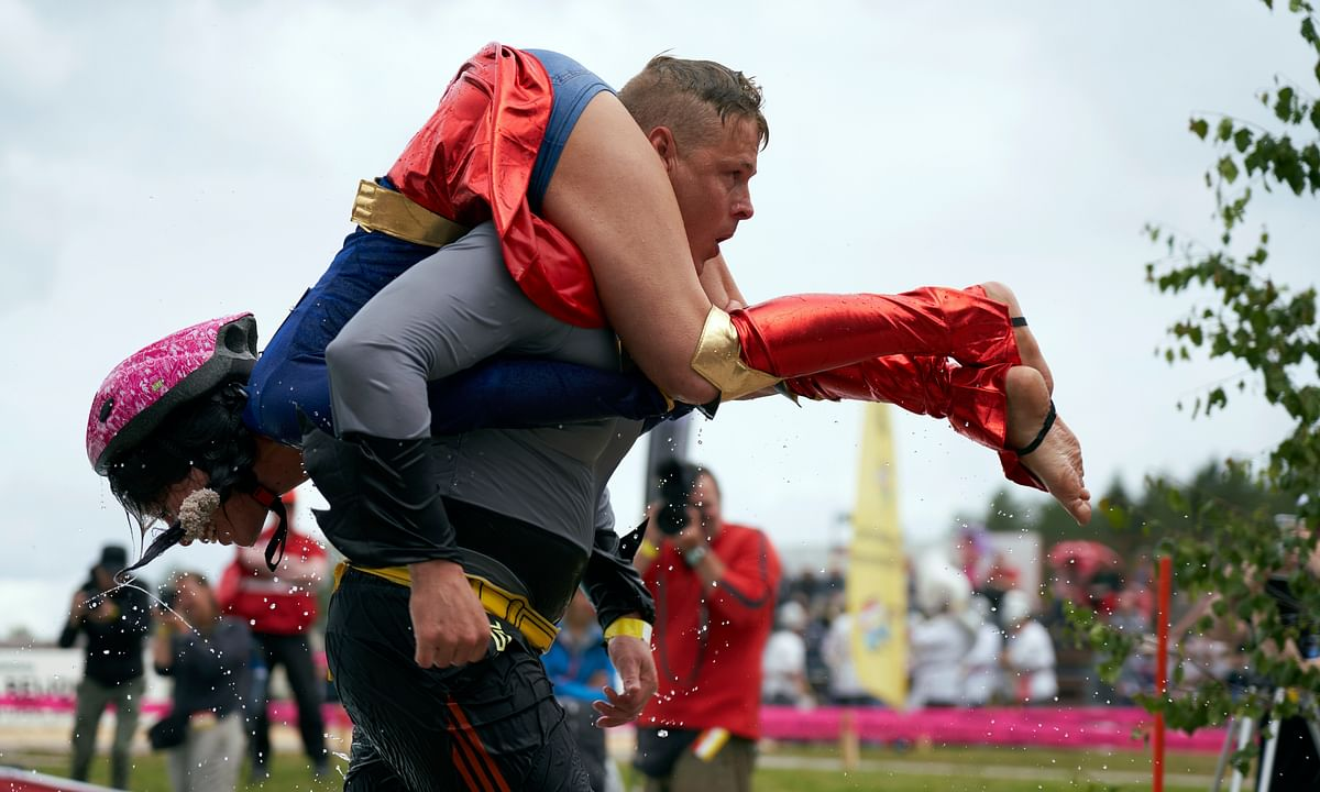 Lithuanian couple upsets host Finland in world 'wife carrying' championship