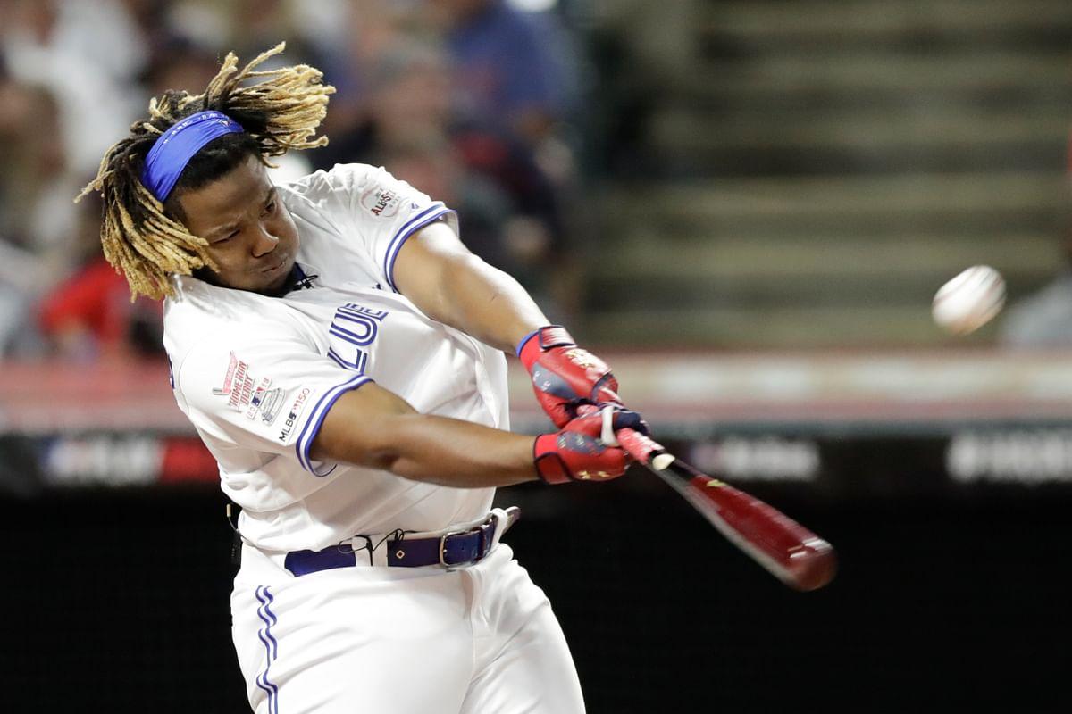 Vladimir Guerrero Jr., of the Toronto Blue Jays, hits during the Major League Baseball Home Run Derby, Monday, July 8, 2019, in Cleveland. (AP Photo/Tony Dejak)
