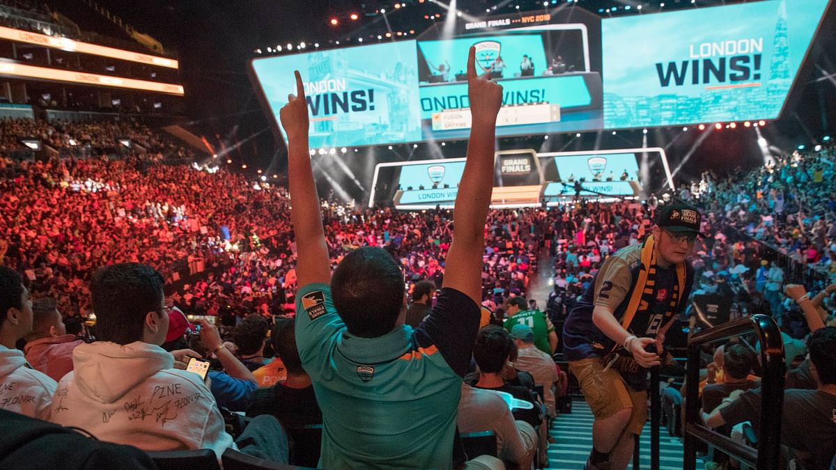FILE - In this July 28, 2018, file photo, London Spitfire fan Rick Ybarra, of Plainfield, Ind., reacts after London won the second game against the Philadelphia Fusion during the Overwatch League Grand Finals competition at Barclays Center in New York. (AP Photo/Mary Altaffer, File)