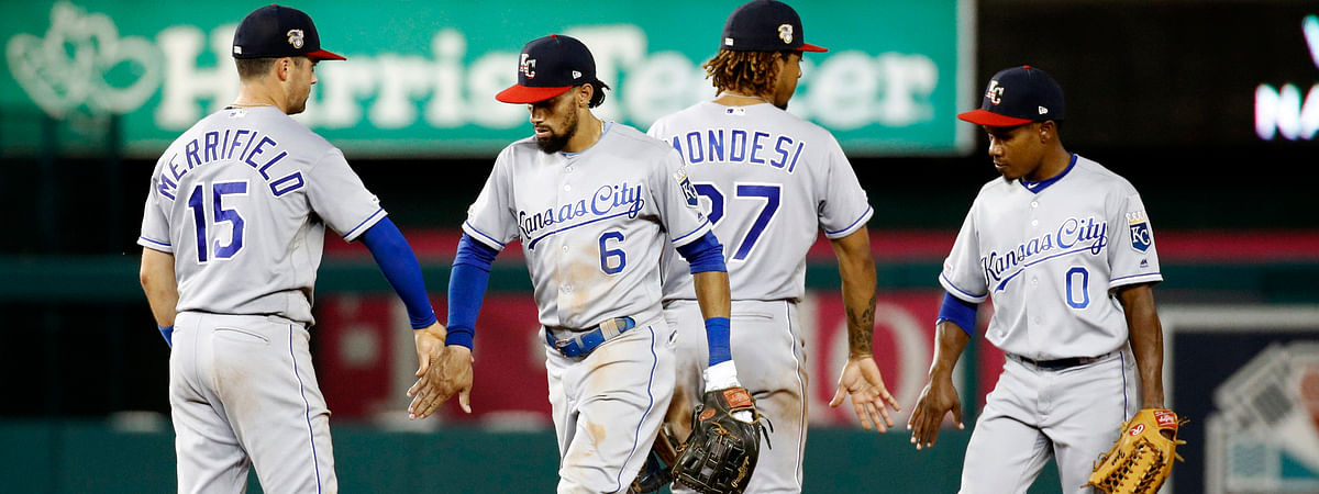 Royals players greet each other after defeating the Nationals on July 5 (Patrick Semansky)