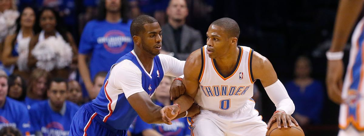 A person with knowledge of the situation says the Oklahoma City Thunder have traded Russell Westbrook (right) to the Houston Rockets for Chris Paul (left), a shake up of top point guards and a move that reunites Westbrook with James Harden, Thursday, July 11, 2019. (AP Photo/Sue Ogrocki, File)