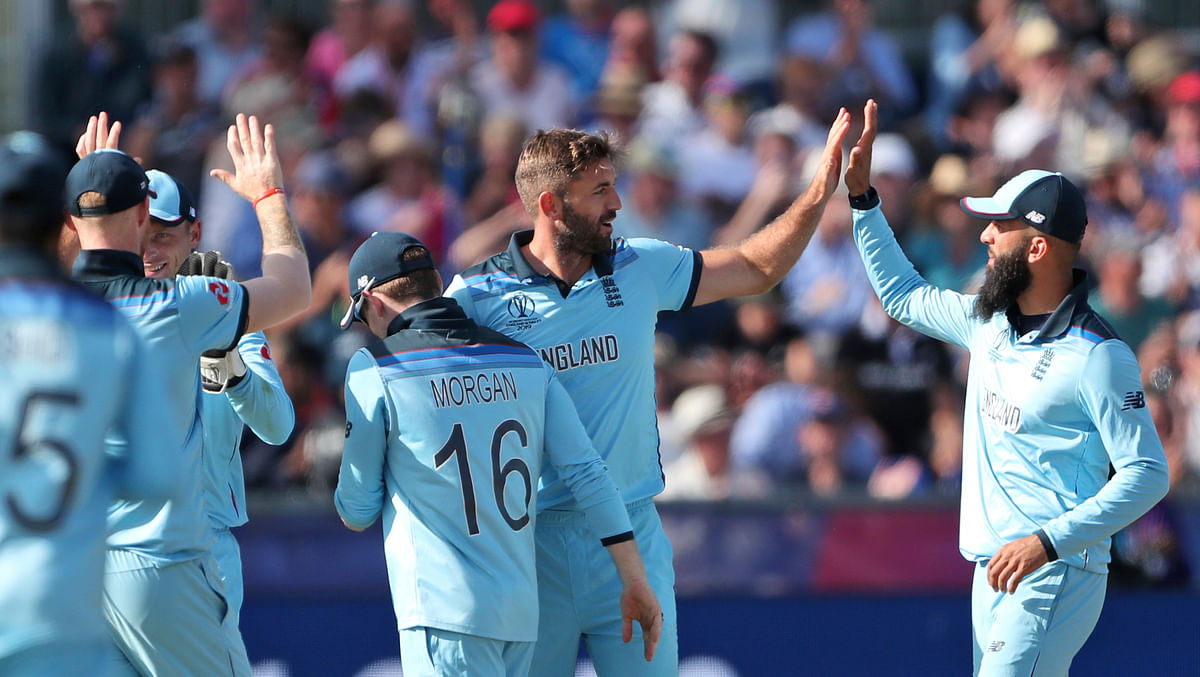 England's cricketers celebrate the dismissal of New Zealand's Tom Latham during the Cricket World Cup match between New Zealand and England in Chester-le-Street, England, Wednesday, July 3, 2019. (AP Photo/Scott Heppell)