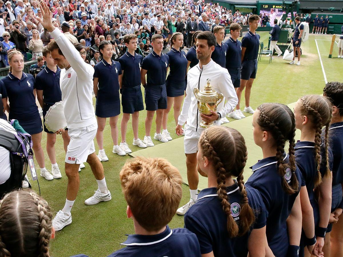 Novak Djokovic speaks at the Wimbledon Champions Dinner, Simona Halep arrives back in Romania