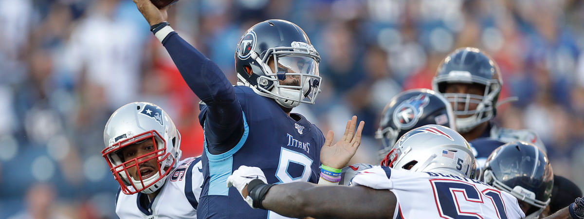 Tennessee Titans quarterback Marcus Mariota (8) passes as he is pressured by New England Patriots linebacker Ja'Whaun Bentley (51) in the first half of a preseason NFL football game on Aug. 17, 2019, in Nashville, Tenn.