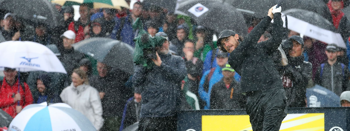 England's Tommy Fleetwood tees off the 9th tee hole in heavy rain during the final round of the British Open Golf Championships at Royal Portrush in Northern Ireland, Sunday, July 21, 2019.