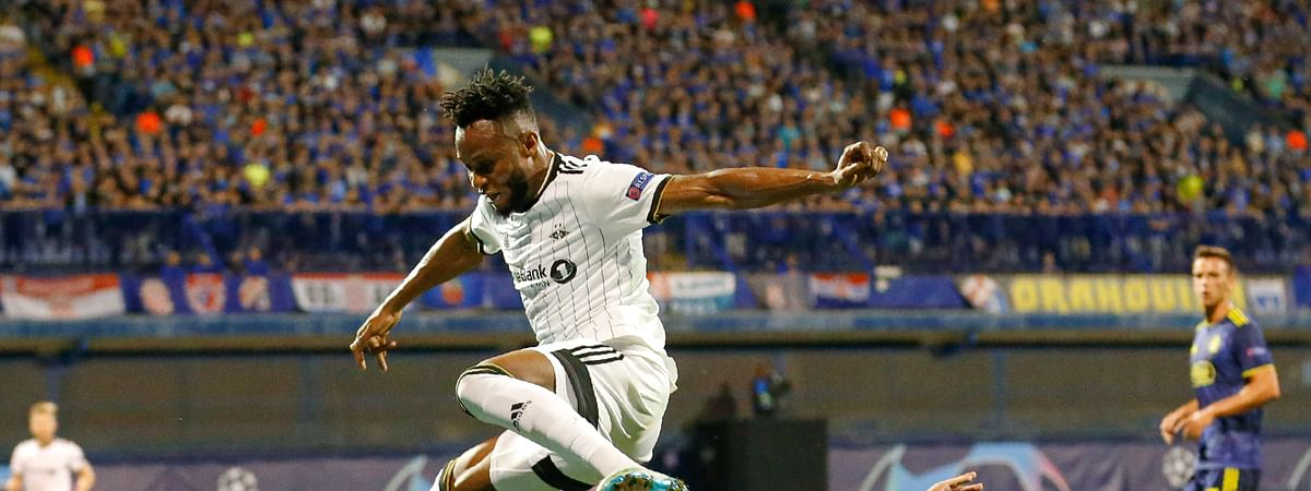 Rosenborg's Samuel Adegbenro, top, is tackled by Dinamo Zagreb's Emir Dilaver during the Champions League qualifying first leg play-off soccer match between Dinamo Zagreb and Rosenborg, in Zagreb, Croatia, Wednesday, Aug. 21, 2019.