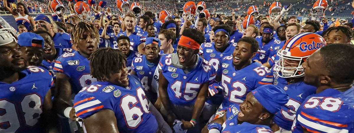 Florida players celebrate after defeating Miami 24-20 in an NCAA college football game Saturday, Aug. 24, 2019, in Orlando, Fla.