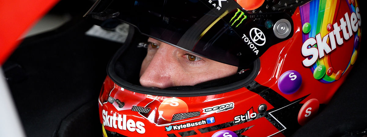 Kyle Busch sits in his car before a practice session for the NASCAR Cup Series auto race on July 27, 2019, in Long Pond, Pa.