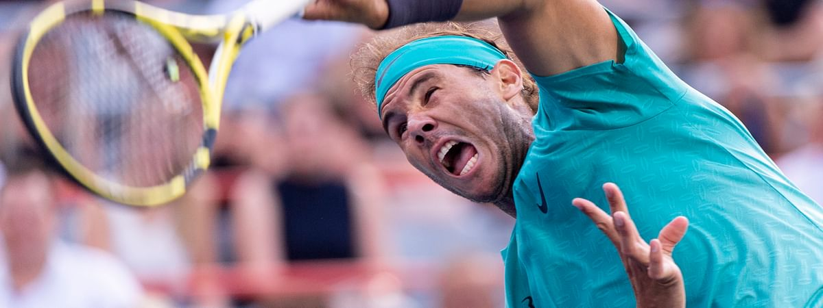 Rafael Nadal, of Spain, serves to Guido Pella, of Argentina, during the Rogers Cup men's tennis tournament Thursday, Aug. 8, 2019, in Montreal. (Paul Chiasson/The Canadian Press via AP)