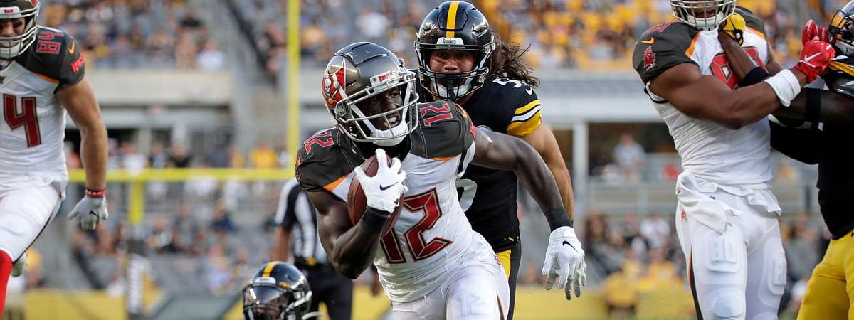 Tampa Bay Buccaneers wide receiver Chris Godwin (12) gets past Pittsburgh Steelers linebacker Anthony Chickillo (56) for a touchdown during the first half of an NFL preseason football game in Pittsburgh, Friday, Aug. 9, 2019.