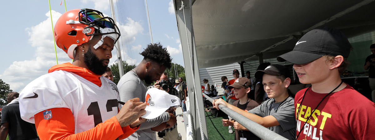 Cleveland Browns wide receiver Odell Beckham Jr. signs autographs after practice at the NFL football team's training camp facility on July 25, 2019 in Berea, Ohio.