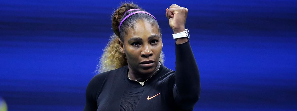 Serena Williams, of the United States, raises her fist after defeating Caty McNally, of the United States, during the second round of the U.S. Open tennis tournament in New York, Wednesday, Aug. 28, 2019. Williams won 5-7, 6-3, 6-1. (AP Photo/Charles Krupa)