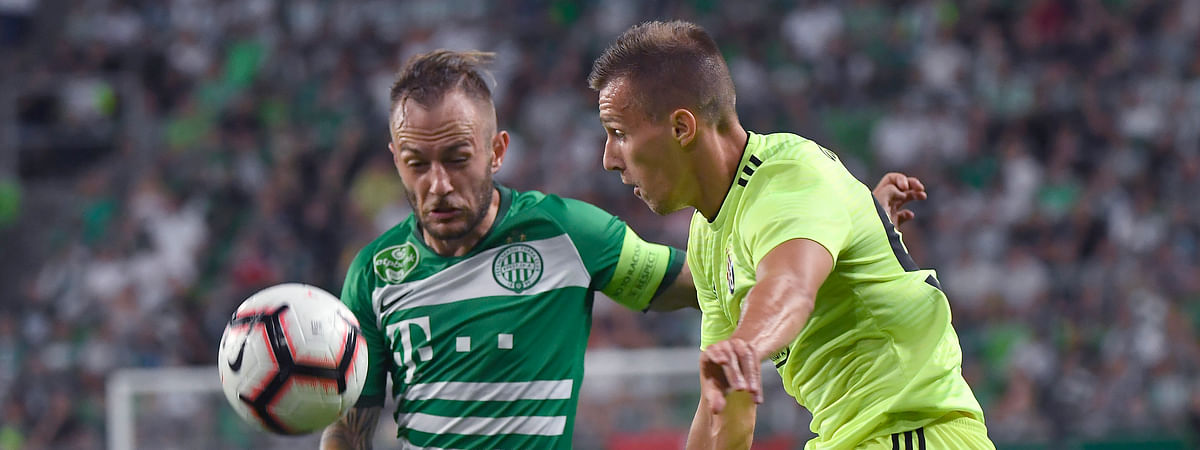 Ferencvaros' Gergely Lovrencsics, left, vies for the ball with Dinamo Zagreb's Mislav Orsic during the Champions League third qualifying round first leg soccer match between Ferencvaros and Dinamo Zagreb in Budapest, Hungary on Aug. 13, 2019.